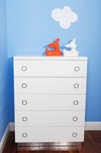 Stock Photo: 1825-4681 Two toys on a sideboard