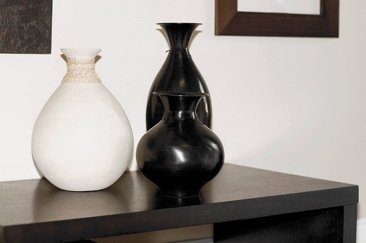 Close_up of vases on a sideboard : Stock Photo