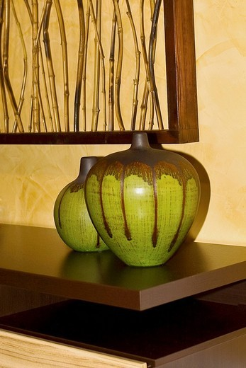Close_up of showpieces on a sideboard : Stock Photo
