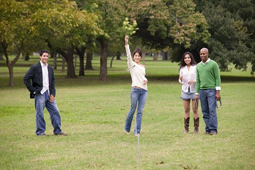 Friends Playing Horseshoes at the Park : Stock Photo