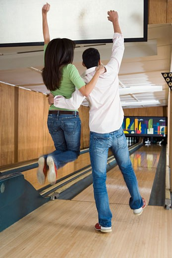 Young Adults Celebrating at Bowling Alley : Stock Photo