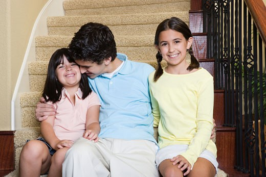 Brother and Sisters on a Staircase : Stock Photo