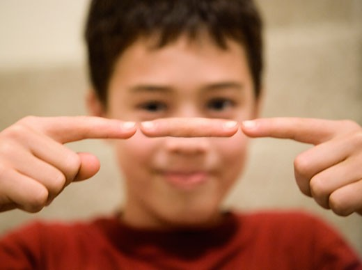 Stock Photo: 1828R-10013 Boy with Levitating Finger