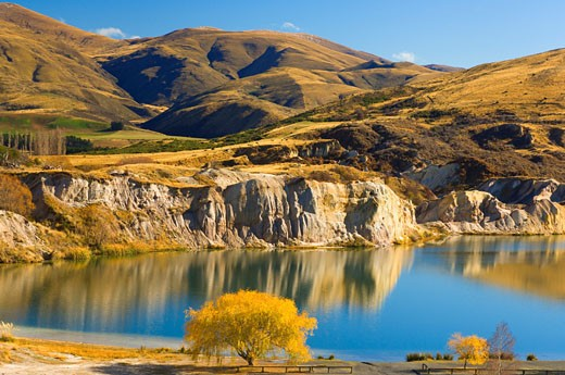 Overview of Foothills and Lake, Blue Lake, St. Bathans, Otago, South Island, New Zealand    : Stock Photo