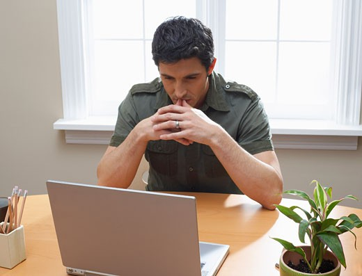 Stock Photo: 1828R-10285 Man Using Laptop Computer