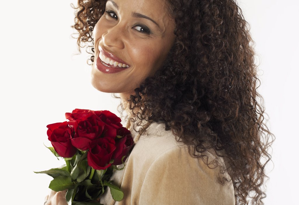 Stock Photo: 1828R-10536 Portrait of Woman Holding Roses