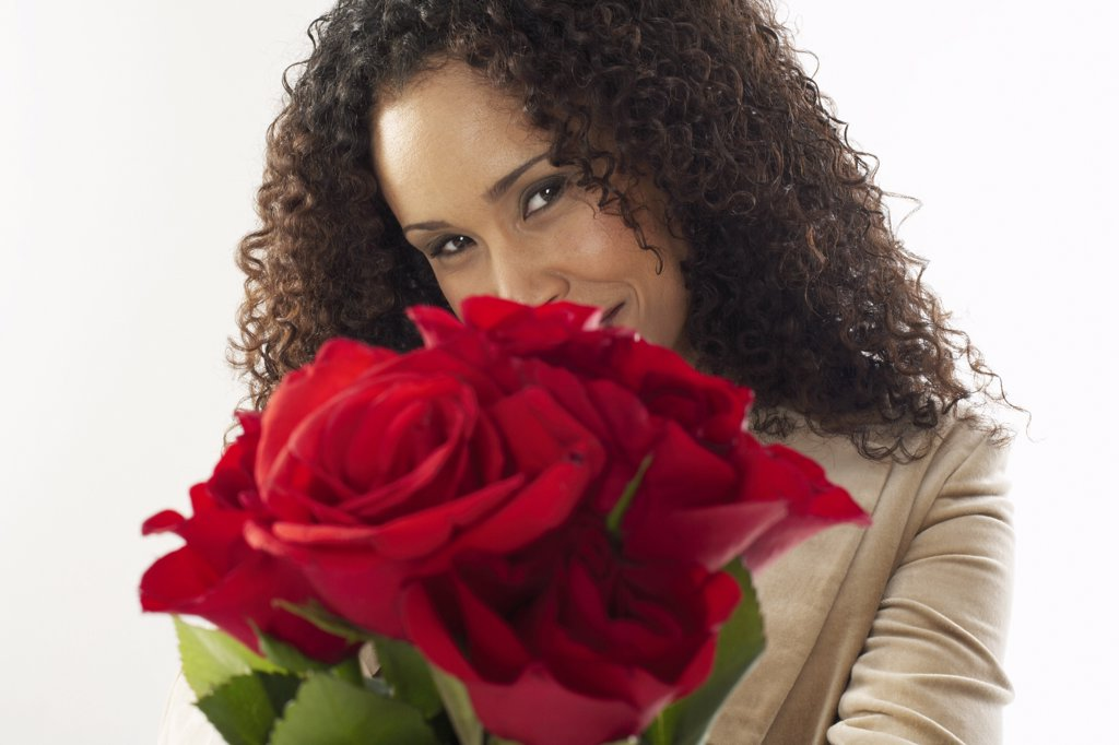 Stock Photo: 1828R-10537 Portrait of Woman Holding Roses