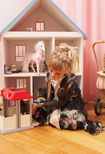 Girl Playing with Doll House : Stock Photo