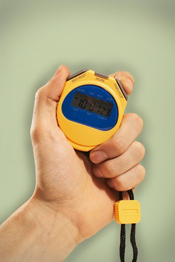 Stock Photo: 1828R-10988 Person's Hand Holding Stopwatch