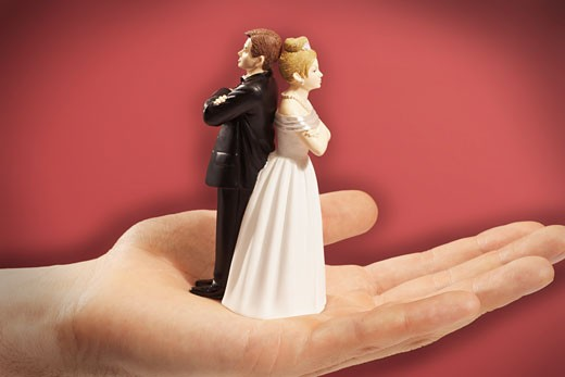 Person's Hand Holding Angry Cake Toppers    : Stock Photo