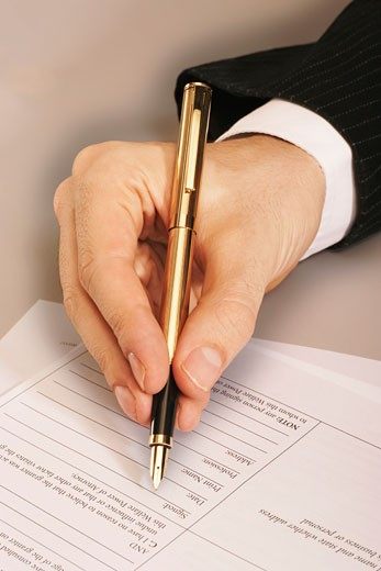 Stock Photo: 1828R-11007 Person's Hand Writing