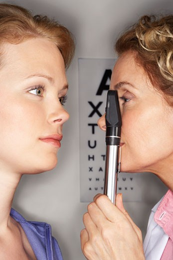 Doctor Performing Eye Test    : Stock Photo