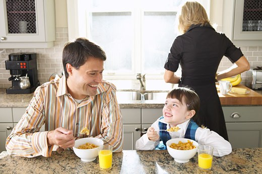 Stock Photo: 1828R-11347 Family Eating Breakfast