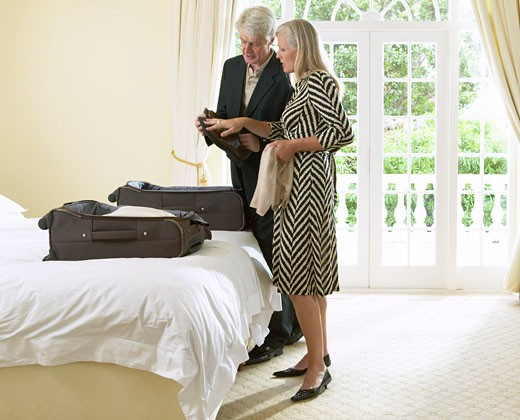 Stock Photo: 1828R-11724 Mature Couple Packing