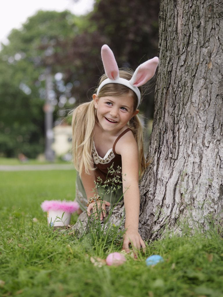 Stock Photo: 1828R-11786 Girl Collecting Easter Eggs