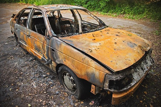 Stock Photo: 1828R-11920 Burnt Out Car Wreck