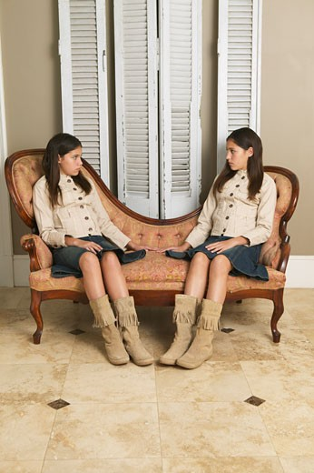 Stock Photo: 1828R-12078 Portrait of Twin Sisters
