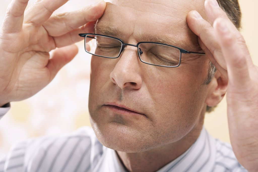 Stock Photo: 1828R-12671 Man With Headache