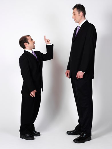 Stock Photo: 1828R-12851 Short and Tall Businessmen