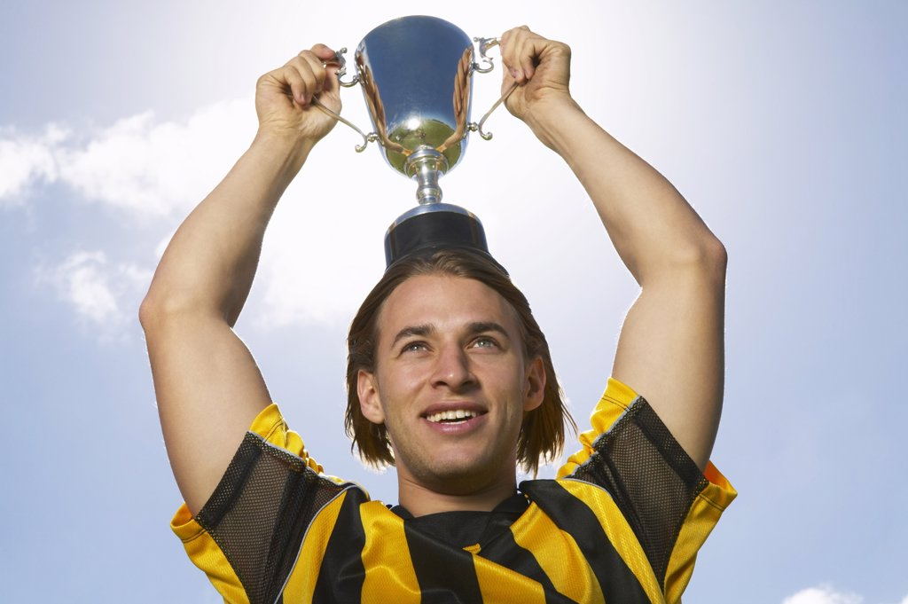 Stock Photo: 1828R-13142 Portrait of Soccer Champion