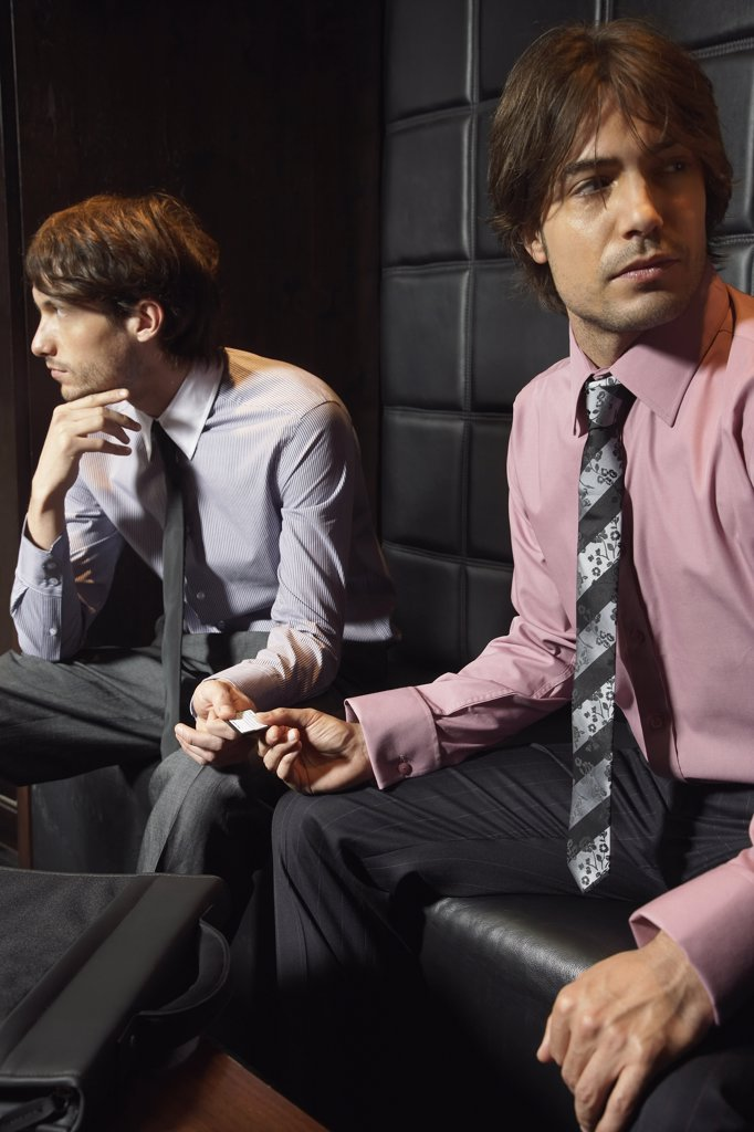 Businessmen Exchanging Microchip    : Stock Photo