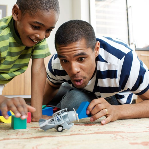 Stock Photo: 1828R-13613 Father and Son Playing with Toys
