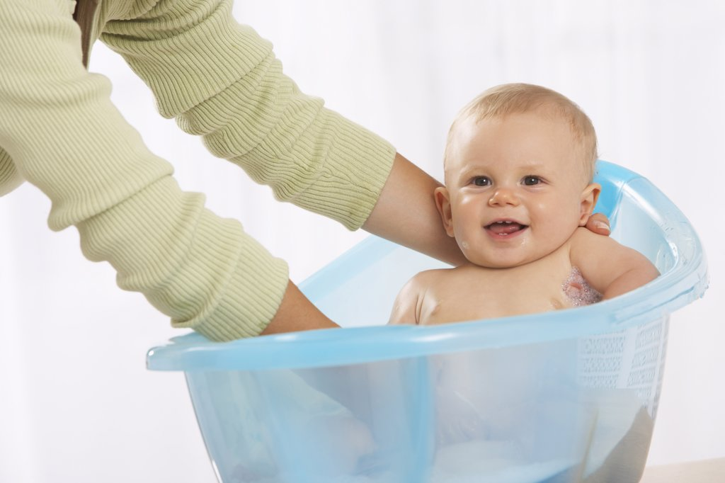 Baby Getting A Bath    : Stock Photo