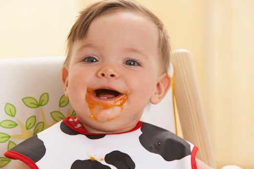 Stock Photo: 1828R-13959 Baby with Food on Face