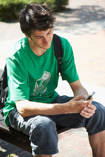Stock Photo: 1828R-14292 Student Using Cell Phone