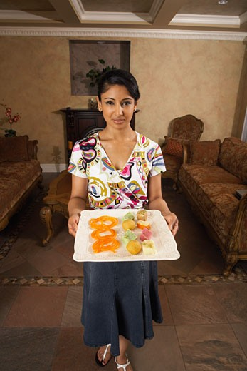 Stock Photo: 1828R-14490 Woman Holding Food Tray