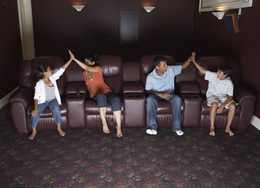 Stock Photo: 1828R-14518 Family Watching Television