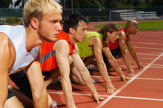 Men Lined up at Starting Blocks    : Stock Photo