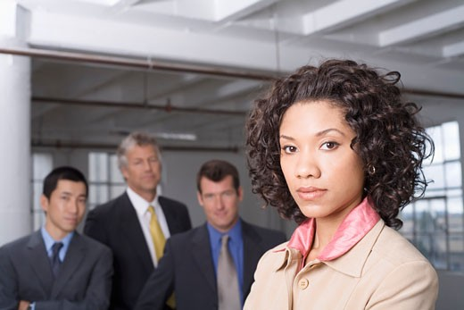 Portrait of Businesswoman with other Business People in Background    : Stock Photo