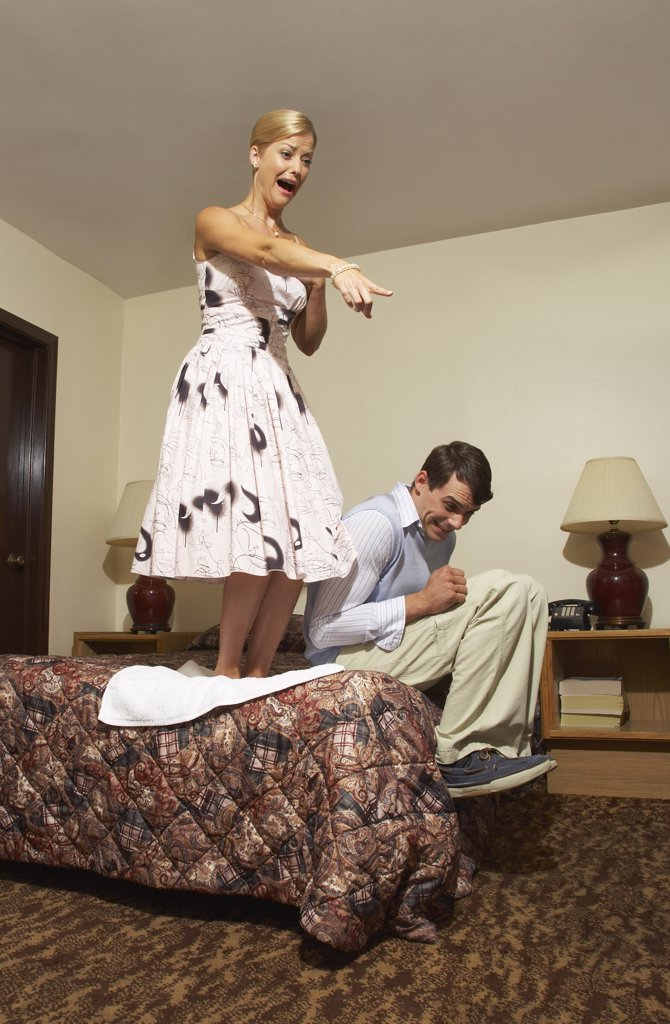 Frightened Couple in Motel Room    : Stock Photo