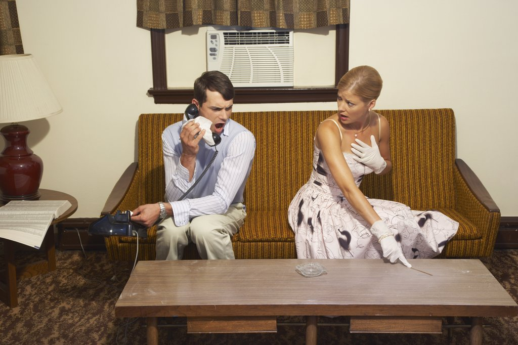 Couple in Motel Room, Inspecting for Dirt    : Stock Photo