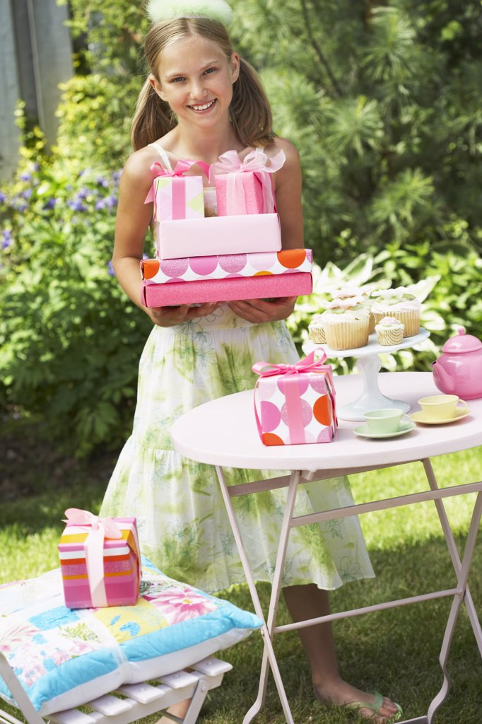 Stock Photo: 1828R-15724 Girl Holding Birthday Gifts