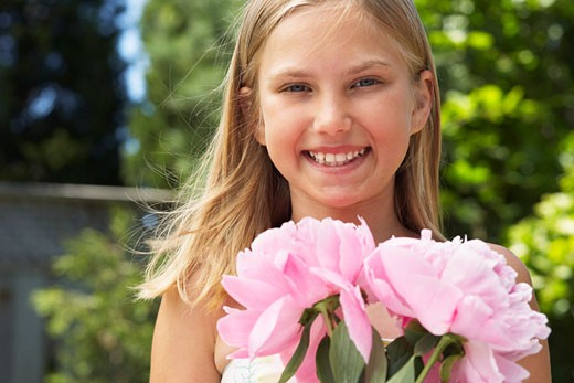 Stock Photo: 1828R-15747 Portrait of Girl Holding Flowers