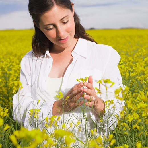 Woman Standing in Canola Field, Alberta, Canada    : Stock Photo