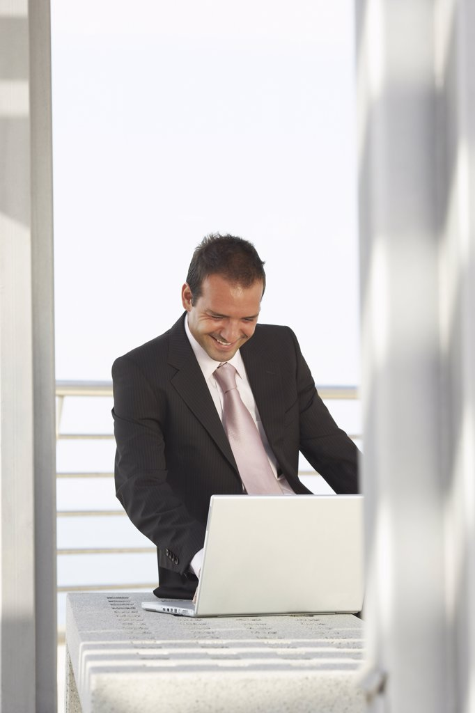 Stock Photo: 1828R-15914 Businessman Using Laptop