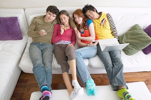 Stock Photo: 1828R-16264 Friends on Sofa