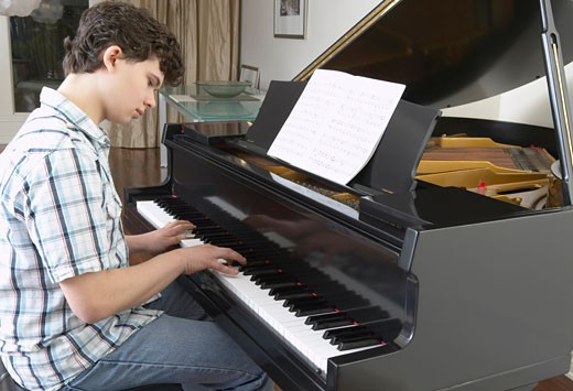 Boy Playing Piano    : Stock Photo