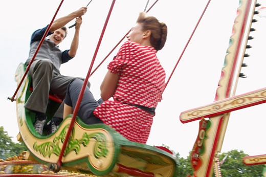 Couple Riding Swingboats, Carters Steam Fair, England    : Stock Photo