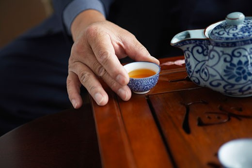 Stock Photo: 1828R-16712 Man Holding Teacup