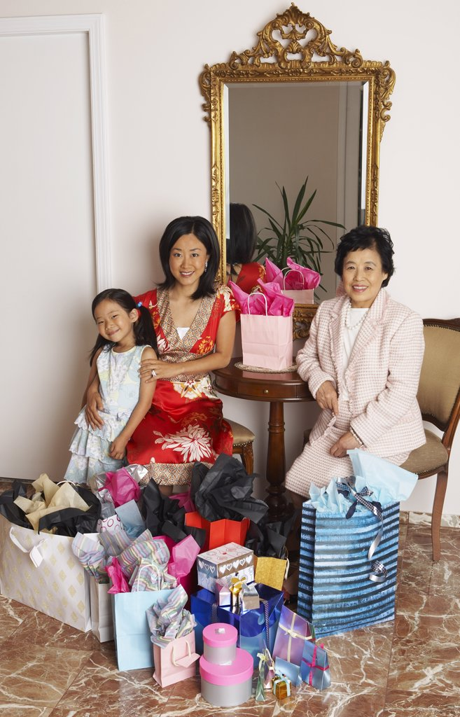 Stock Photo: 1828R-16762 Portrait of Family with Shopping Bags