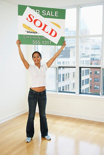 Stock Photo: 1828R-16965 Woman Holding Sold Sign