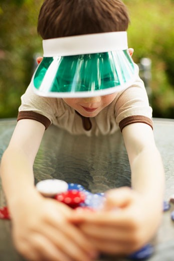 Stock Photo: 1828R-17009 Boy with Poker Chips