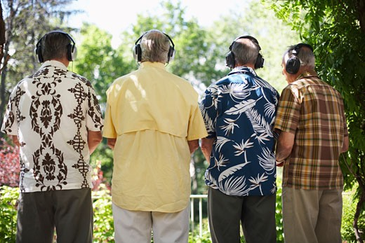Stock Photo: 1828R-17017 Men Wearing Headphones Listening to Music