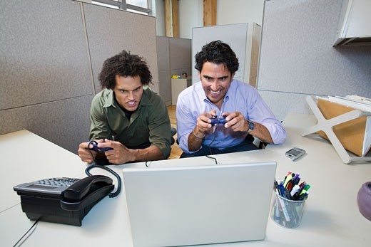 Coworkers Playing Video Game in Office    : Stock Photo