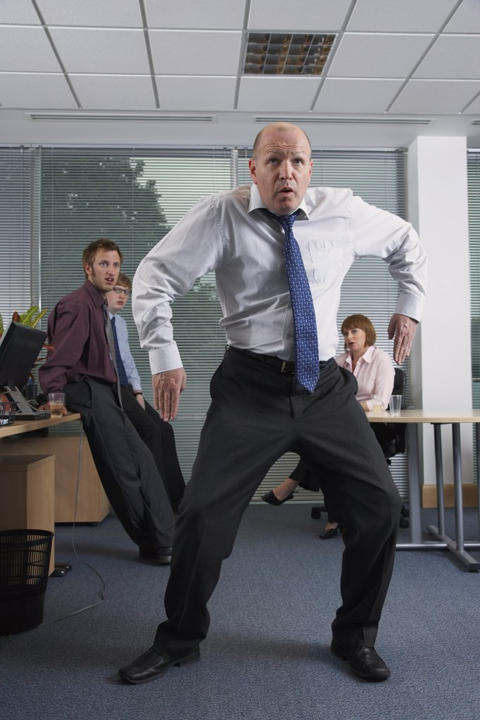 Stock Photo: 1828R-17279 Manager Dancing for Staff in Office