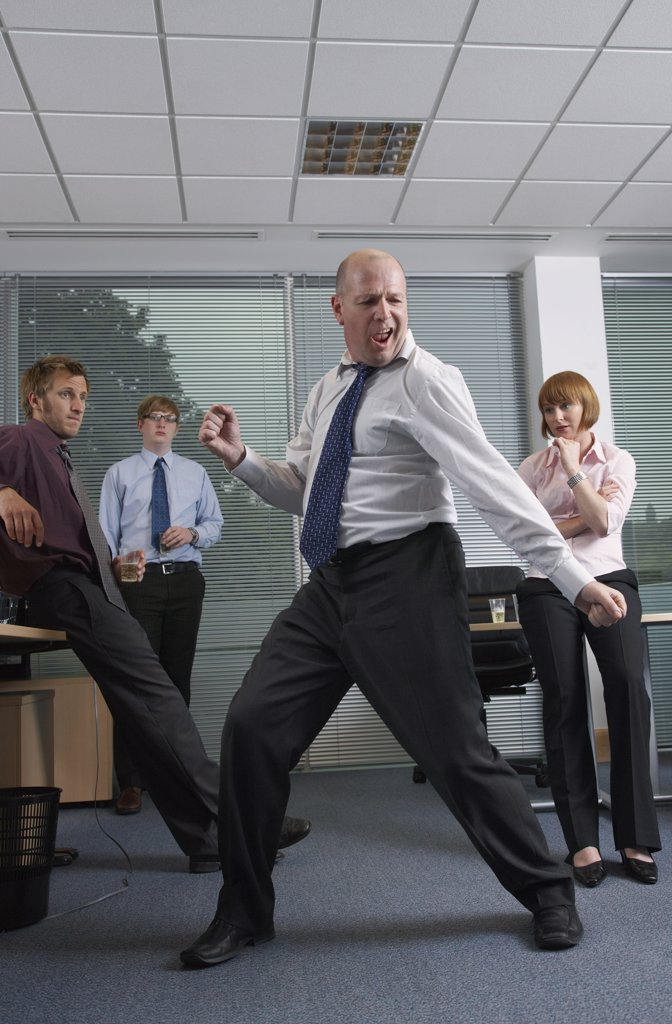 Manager Dancing for Staff in Office    : Stock Photo